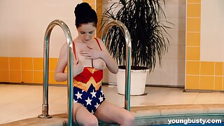 Amazing busty pool chick Angel Nobles loves fingering her soaking slit