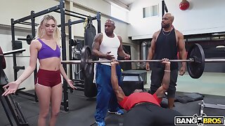 Cute white girl interrupts a gymnastics and ends down getting fucked by black men